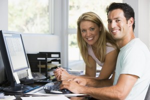 photodune_337512_couple_in_home_office_with_computer_smiling_s.jpg